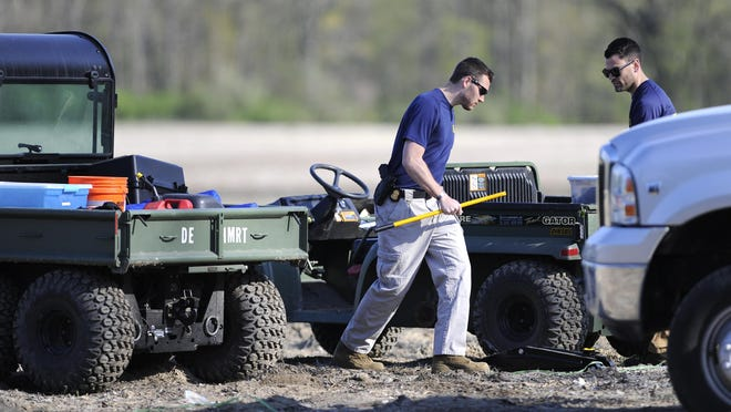 FBI agents from the Detroit Field Office. Officers using shovels and excavation equipment began digging at the Macomb Township site Monday.