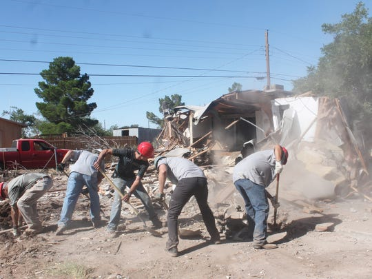 In this file photo, Airmen from Holloman Air Force Base work shoveling debris during the demolition of a Tularosa home in July as part of the Big Give.