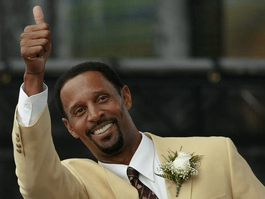 James Lofton gives a thumbs up to the section of cheering Green Bay Packers fans at his enshrinement to the Pro Football Hall of Fame in Canton, Ohio, in 2003. Lofton began his NFL career with the Packers as a first-round pick in 1978.