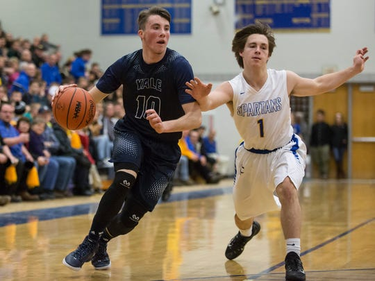 Yale senior Cody Kegley drives the ball down court during a basketball game Friday, Feb. 12, 2016 at Imlay City High School.