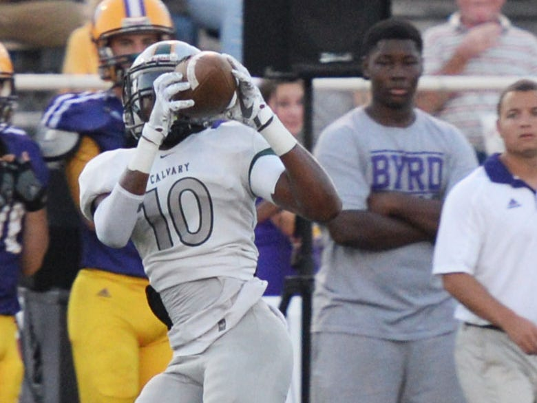 Calvary's Fred Davis scored one of his team's 8 touchdowns against Lakeside.