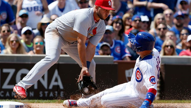 St. Louis Cardinals third baseman Jhonny Peralta, left, tags out Chicago Cubs' Javier Baez at third during the fifth inning of a baseball game, Saturday, June 3, 2017, in Chicago. (AP Photo/Nam Y. Huh)