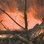 Fire crews battled a wildfire near Merced on May 27, 2014.