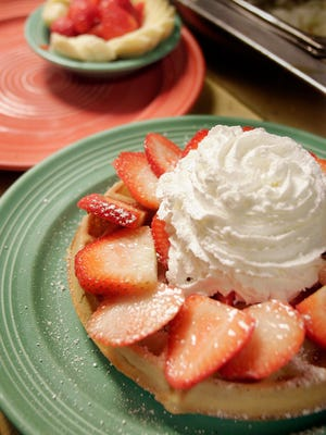 Country Harvest Restaurant in Newbury Park offers a full menu and Sunday brunch. A waffle covered with fresh strawberries and whipped cream is on the menu.