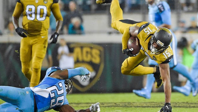 Titans cornerback Perrish Cox (29) stops Jaguars wide receiver and Orchard Lake St. Mary's product Allen Robinson (15) after a reception during the second half Thursday night  in Jacksonville, Florida.