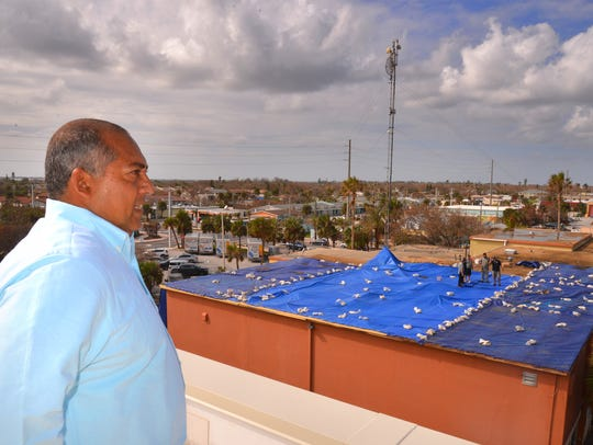 In this September photo, Cocoa Beach Mayor Ben Malik surveys Hurricane Irma roofing damage to the police station and City Hall from the roof of the neighboring fire station.