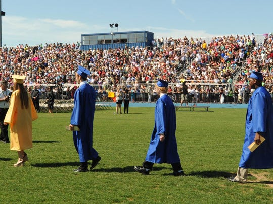 Football stands were filled to capacity in 2014 as Caesar Rodney High School graduated 422 seniors.