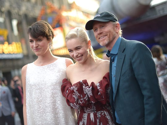 "Phoebe Waller-Bridge (left) poses with co-star Emilia Clarke and director Ron Howard at the world premiere of ""Solo: A Star Wars Story."""