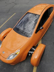 The Elio, a three-wheeled prototype vehicle, is shown in Royal Oak, Mich. Elio Motors was able to raise nearly $17 million from investors through Regulation A.