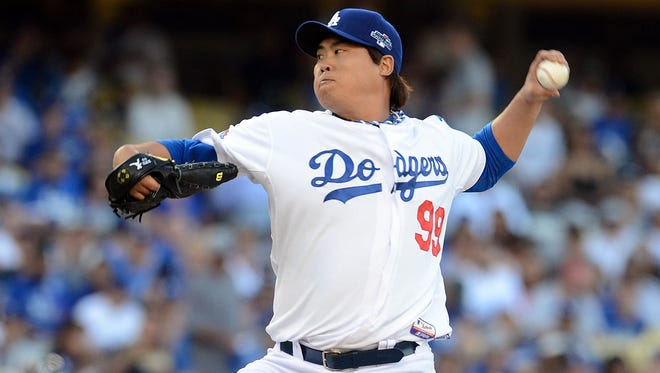 Los Angeles Dodgers starting pitcher Hyun-Jin Ryu pitches against the Atlanta Braves in Game 3 of the National League divisional series at Dodger Stadium.