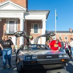 Scott McMullan moves his Delorean outside of the Sussex County Courthouse as part of Back to the Future Day in Hill Valley on Wednesday afternoon.