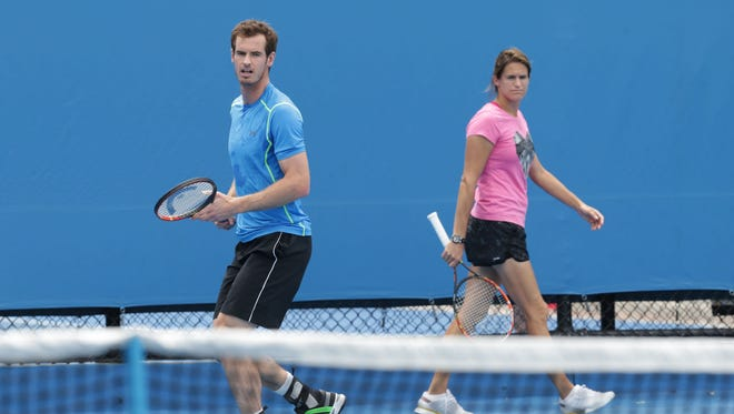 Andy Murray of Great Britain in a practice session as new coach Amelie Mauresmo watches on during day two of the 2015 Australian Open at Melbourne Park on January 20, 2015 in Melbourne, Australia.