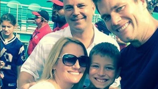 The Carr family is pictured with Tom Brady in December.