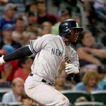 Yankees shortstop Didi Gregorius (18) hits an RBI single in the eighth inning of their game against the Atlanta Braves at Turner Field Friday.