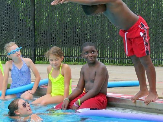 Swim instructor Mackenzie Tatum watches students Sophie