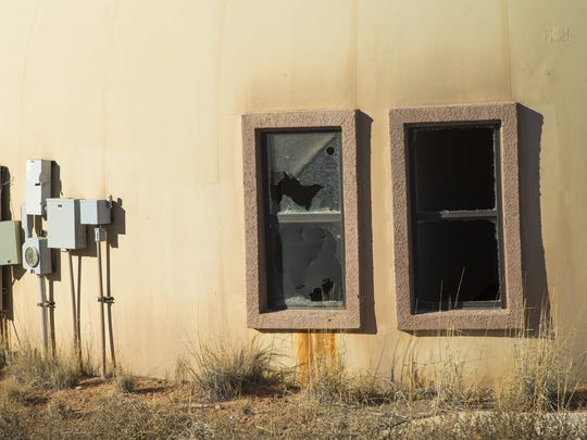 New homes built by the Navajo Housing Authority often remain empty and end up being vandalized and in disrepair like these fourplexes in Tolani Lake, Ariz.