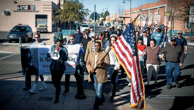 Doña Ana NAACP President Curtis Rosemond and Bobbie Green, first vice president of the group, lead the 2015 Martin Luther King Jr. March. This year's march will begin at 2 p.m. Sunday at Las Cruces City Hall.
