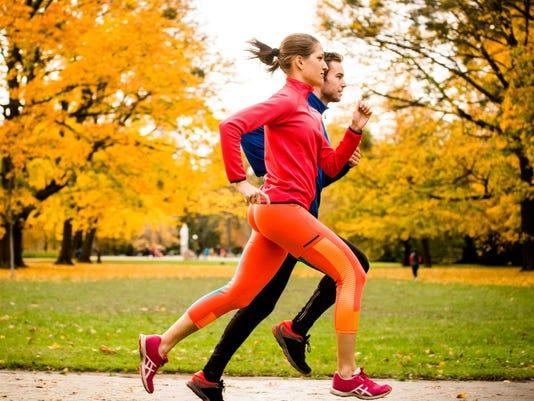 Couple jogging in autumn nature