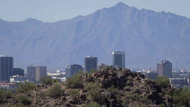 The Phoenix skyline is clear from Piestewa Peak, looking south toward South Mountain, Monday morning, Sept. 14, 2014. The Valley's recent rain and breezes have cleared the air of particulates, allowing for hikers and others to see across the metropolitan area.