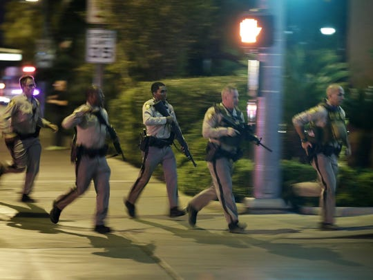 Police run to the scene of a shooting near the Mandalay Bay Resort and Casino on the Las Vegas Strip last Sunday.