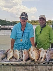 Fred Keeler, on left, and a friend caught this mess of fish while fishing in Mission Bay.