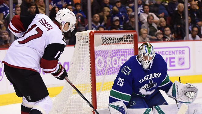 Nov 17, 2016: Arizona Coyotes forward Radim Vrbata (17) shoots the puck against Vancouver Canucks goaltender Jacob Markstrom (25) during the second period at Rogers Arena.