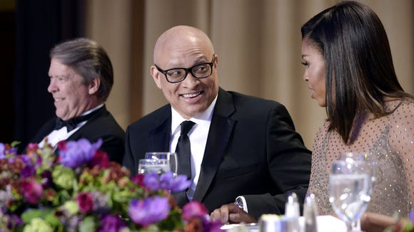 Comedian Larry Wilmore speaks with First Lady Michelle
