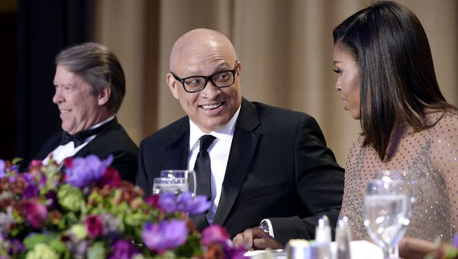 Comedian Larry Wilmore speaks with First Lady Michelle Obama during the White House Correspondents' Association Dinner.