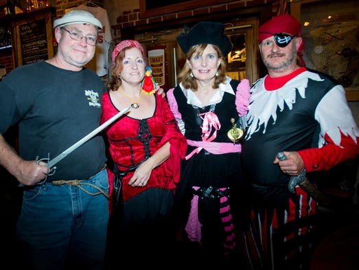 Adult Halloweeners visit local bars and taverns in