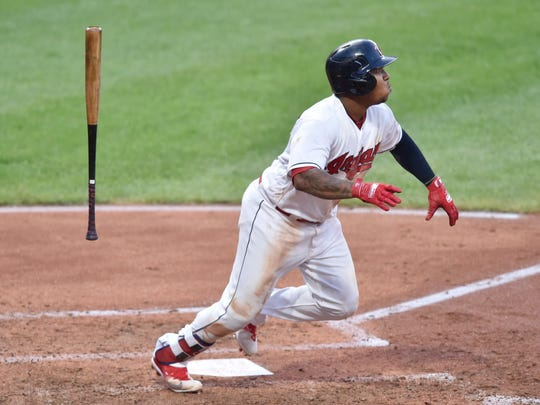 Jul 12, 2018; Cleveland, OH, USA; Cleveland Indians third baseman Jose Ramirez (11) watches the flight of his solo home run in the fifth inning against the New York Yankees at Progressive Field.