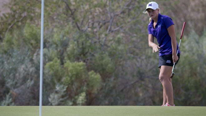 Carly Strole watches her putt on the 6th hole, Nov. 3, 2016, during the Division I Girls Golf State Championships at Aguila Golf Course, 8440 S. 35th Ave., Laveen.
