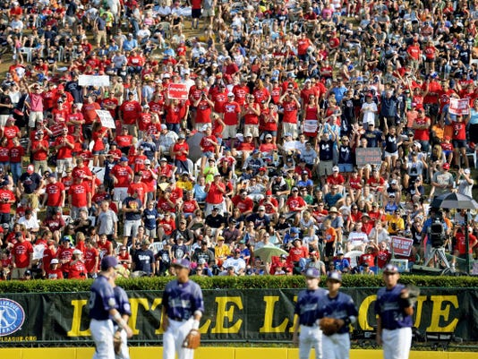 Red Land fans, among the announced attendance of 45,716, cheer their team as Pearland players wait for relief pitcher Marco Gutierrez to finish warming up in the sixth inning Saturday, Aug. 29, 2015, during the Little League World Series U.S. championship game featuring Red Land Little League of Pennsylvania and Pearland West Little League of Texas, in South Williamsport. Red Land defeated Pearland 3-2 in a walk-off victory to move on to the world championship game against Tokyo Kitasuna of Japan. Chris Dunn — Daily Record/Sunday News