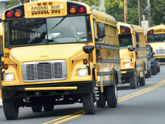 Buses leave Benjamin Chambers Elementary School after classes Monday. A committee is looking into redistricting due to overcrowding at some elementary schools.
