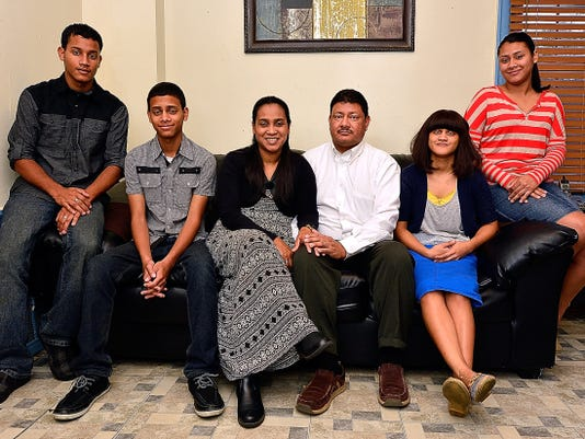 Pastor Jose Rodriguez-Santiago,center, and his family are ministering together.  Pictured with him recently, from left, are sons Andres, 17, and Daniel, 14; wife Yolanda Nieves; and daughters Ruth, 18, and Idalis, 20.