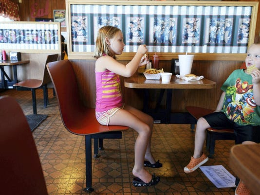 Leila Steuernagle, 6, left, and her brother Owen Steuernagle, 3, of Airville eat dinner at Collinsville Drive-In in Chanceford Township in August.