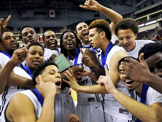 Impact Academy players celebrate after winning the District 3 Class A title game at Giant Center on Friday. After a first half littered with turnovers from both teams, Impact pulled away in the second for a 65-59 win vs. Millersburg.