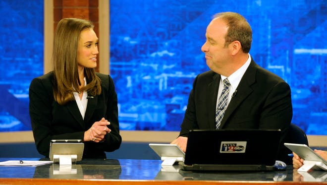 KTXS anchor Braid Blanks (left) laughs with co-anchor George Levesque during a commercial break in her final newscast on Friday, March 3, 2017.