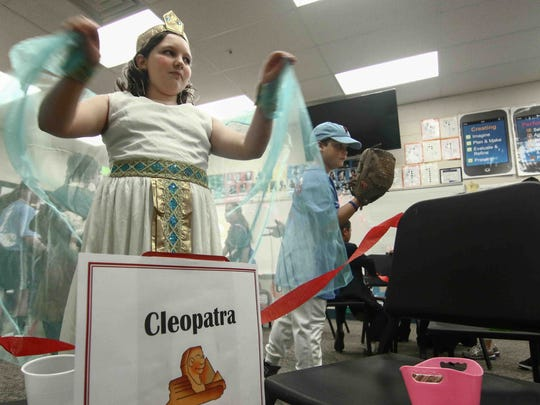 Charlotte Curley, 10, plays Cleopatra during an Art show, Science fair, and wax museum exhibition Tuesday, Mar. 15, 2016, at Forwood Elementary near Wilmington.