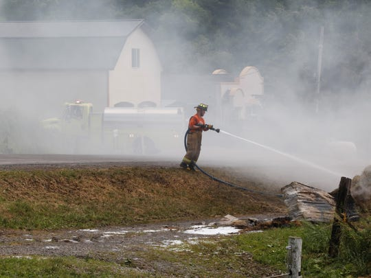 Firefighter responded to a rekindled fire at a beef barn on Mount Pleasant Road in Varna.