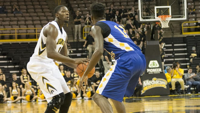 Dale Jones squares up against Coppin State's Terry Harris in a November game.