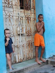 """Two Boys"" taken by Victoria Blewer on a recent trip to Cuba, on display at Frog Hollow in Burlington."