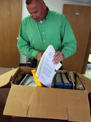 Burlington Police Lt. Jeff Klein opens the box of evidence from the murder of real estate agent Dorothy Miller on July 22, 2015, at the Burlington Police Department. The murder took place in 1969 and is the oldest unsolved case in Burlington.