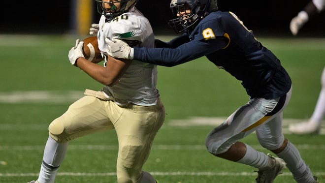 Carter Giacomo, right, looks to make a tackle during Streetsboro's first-round tournament game last season.