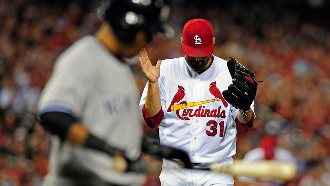 Cardinals pitcher Lance Lynn celebrates after getting Yankees third baseman Yangervis Solarte to pop out to end the top of the sixth inning at Busch Stadium.