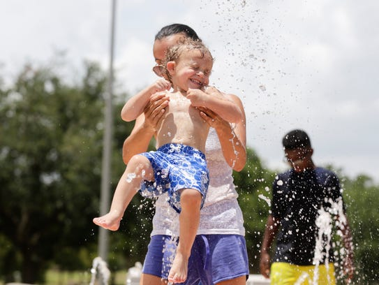Ashley James plays with her son Zyler in the water