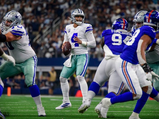 Sep 8, 2019; Arlington, TX, USA; Dallas Cowboys quarterback Dak Prescott (4) drops back to pass against the New York Giants during the second half at AT&T Stadium. Mandatory Credit: Jerome Miron-USA TODAY Sports
