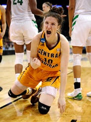 Central Michigan's Cassie Breen celebrates a basket and foul against Oregon.