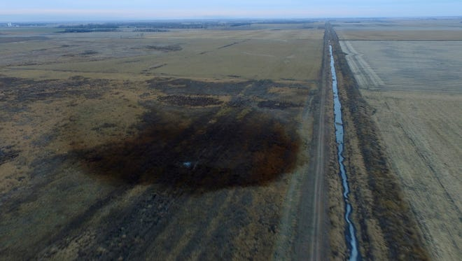 This aerial photo shows spills from TransCanada Corp.'s Keystone pipeline, Friday, Nov. 17, 2017, that leaked an estimated 210,000 gallons of oil onto agricultural land in northeastern South Dakota, near Amherst, S.D., the company and state regulators said Thursday, but state officials don't believe the leak polluted any surface water bodies or drinking water systems. Crews shut down the pipeline Thursday morning and activated emergency response procedures after a drop in pressure was detected resulting from the leak south of a pump station in Marshall County, TransCanada said in a statement. The cause was being investigated.