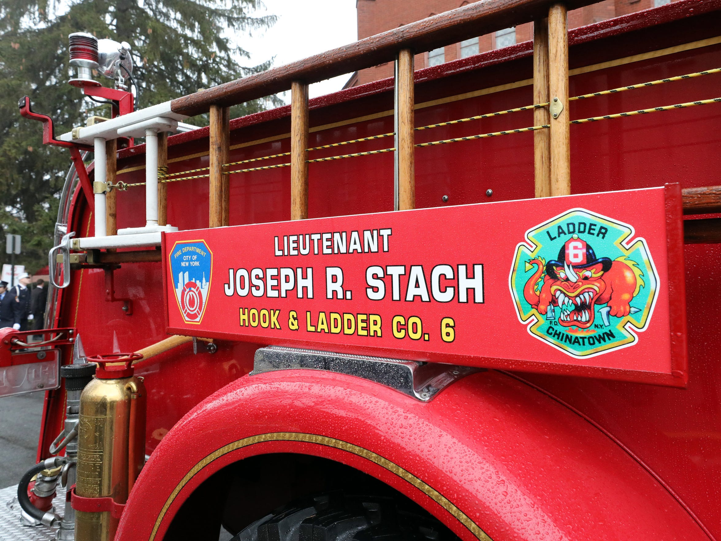 A memorial name plate for FDNY Lt. Joseph Stach is seen on the side of a historical FDNY engine at St. Ann's Church in Nyack, Jan. 12, 2018. Stach died from his battle with 9/11 related pancreatic cancer. He retired from the FDNY in 2010 and was also a Life Member of the Empire Hook & Ladder Co. #1 in Upper Nyack.