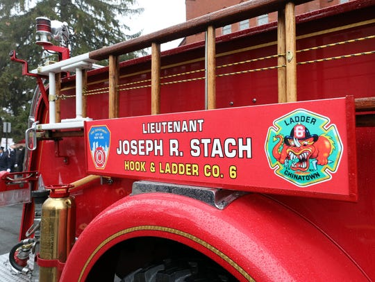 A memorial name plate for FDNY Lt. Joseph Stach is seen on the side of a historical FDNY engine at St. Ann's Church in Nyack, New York, on Jan. 12, 2018. Stach died from his battle with 9/11-related pancreatic cancer. He retired from the FDNY in 2010 and was also a Life Member of the Empire Hook & Ladder Co. #1 in Upper Nyack.